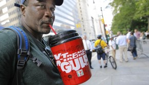 Kathy WillensFILE - In this July 9, 2012 file photo, protester Eric Moore sips on an extra-large beverage during a protest against Mayor Michael Bloomberg's proposal to prohibit licensed food establishments from using containers larger than 16 ounces to serve high-calorie drinks at City Hall in New York. The era of the supersized cola may come to an end in New York City on Thursday, Sept. 13, 2012, when health officials are expected to approve the 16-ounce limit. (AP Photo/Kathy Willens, File)
