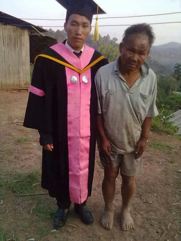 According to comments online, the son is posing with his father, who is a poor farmer in Thailand.